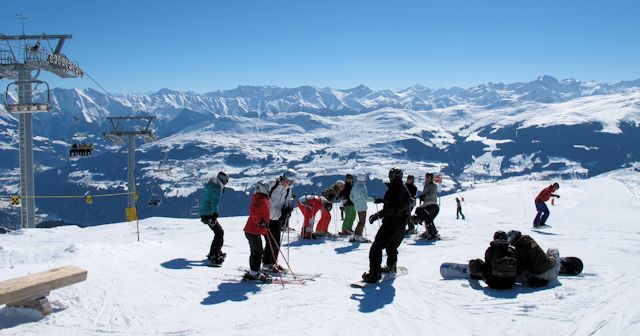 Skiers and Snowboarders in Brigels take in the view